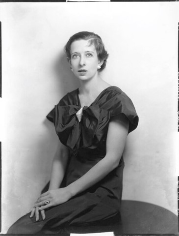 Maria Nys Huxley in 1954. She sits with her hands crossed in front on her lap.