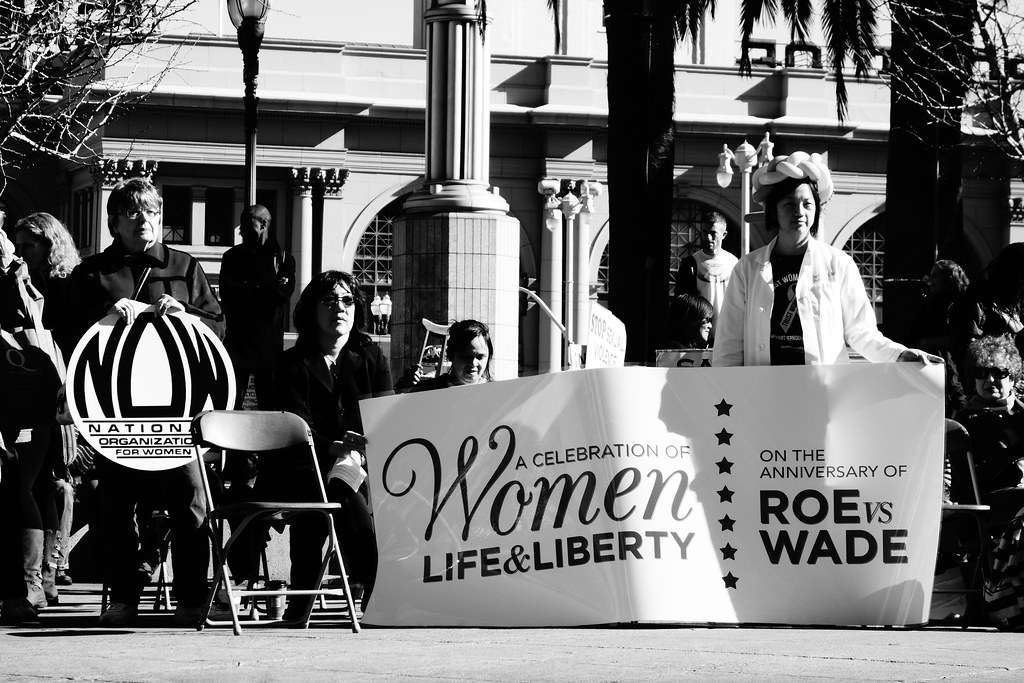 A group of women holding signs in support of women's reproductive rights at the 40 years of Roe v. Wade anniversary in San Francisco, California