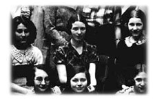 Simone de Beauvoir in 1933. She is sitting surrounded by other young girls.